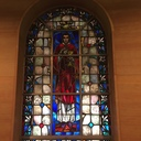 Window in the Chapel of a Deacon holding the Blessed Sacrament.